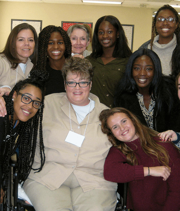 Mercer students and women incarcerated at Pulaski State Prison pose for a photo during a Building Community/Inside-Out class.