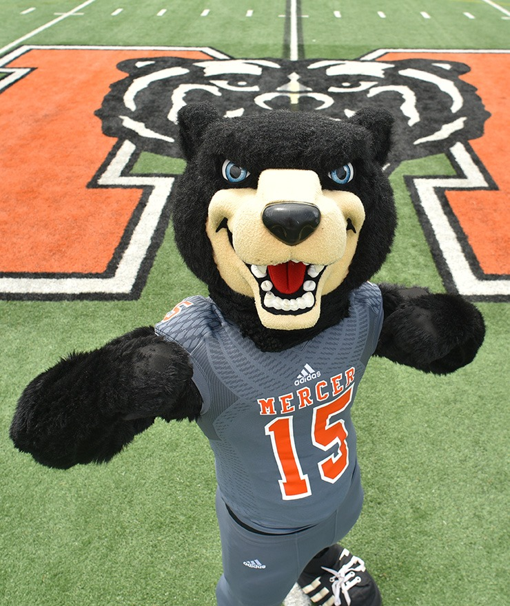 Mercer mascot Toby stands on the football field.