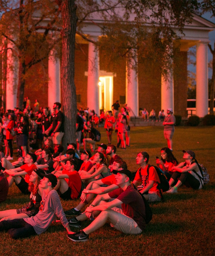 Students watch fireworks during a Pilgrimage to Penfield event.