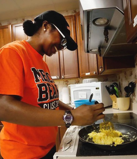 Mary-Angel Ekezie cooks eggs during a MerServe community service activity over spring break 2019.