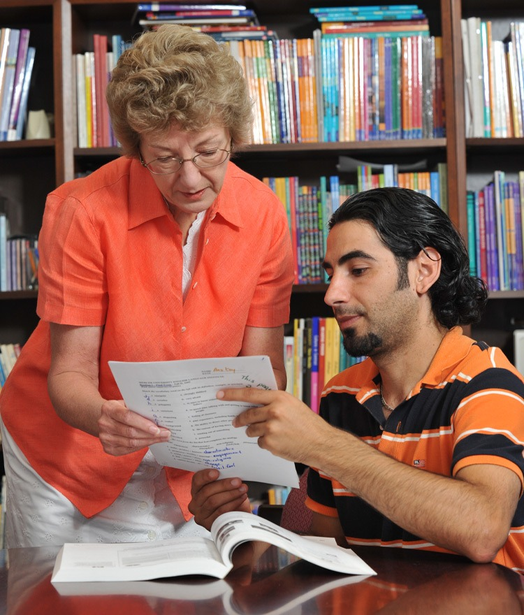 A Mercer professor works with a student at the English Language Institute.