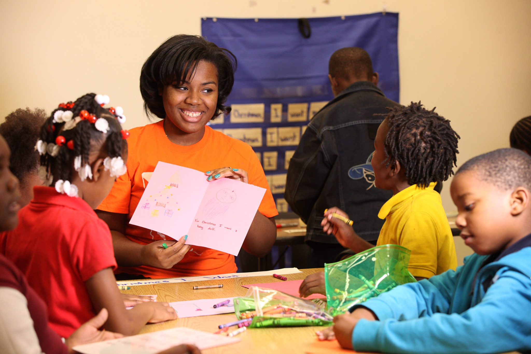 A Mercer University student works with young children to help improve reading scores.
