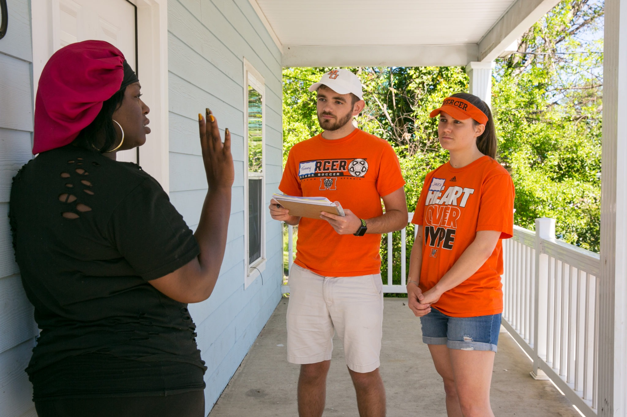 Mercer University students talk to a woman in the community as part of the 2017 Mercer Service Scholars program.