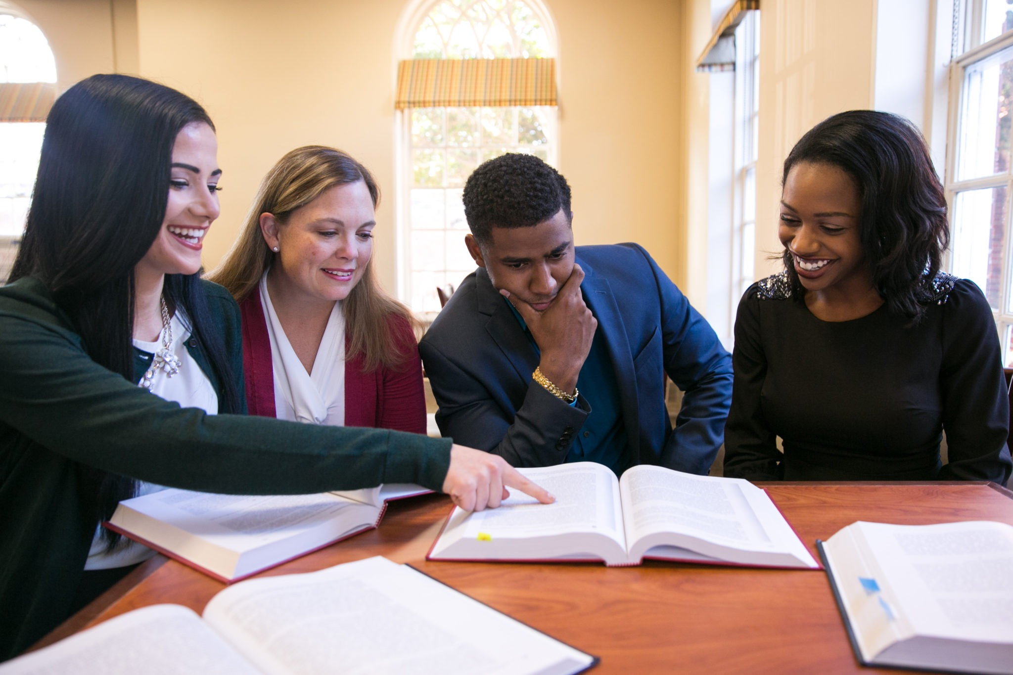Students study together around a table.