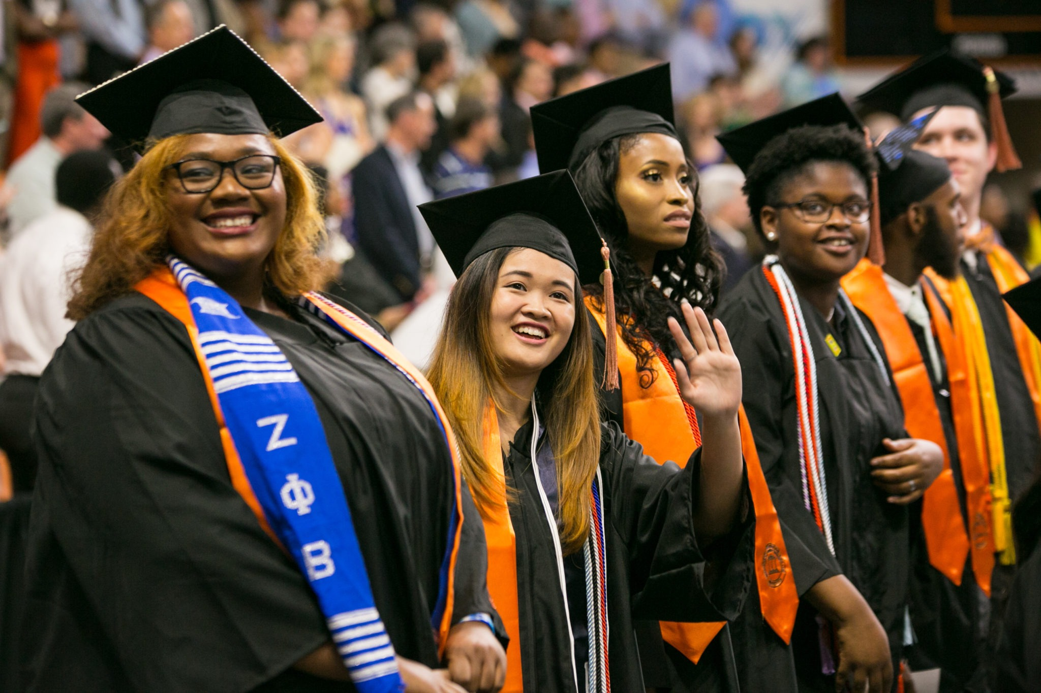 Students are shown in their caps and gown at 2018 commencement in 2018.