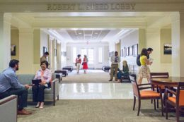 People walk through the Robert Steed Lobby of the Law School.