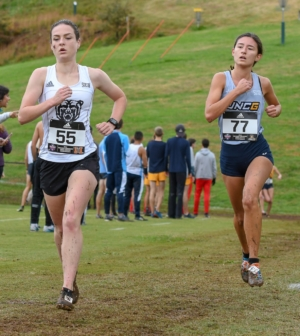 Women's cross country team member Hannah Corson runs down the field.