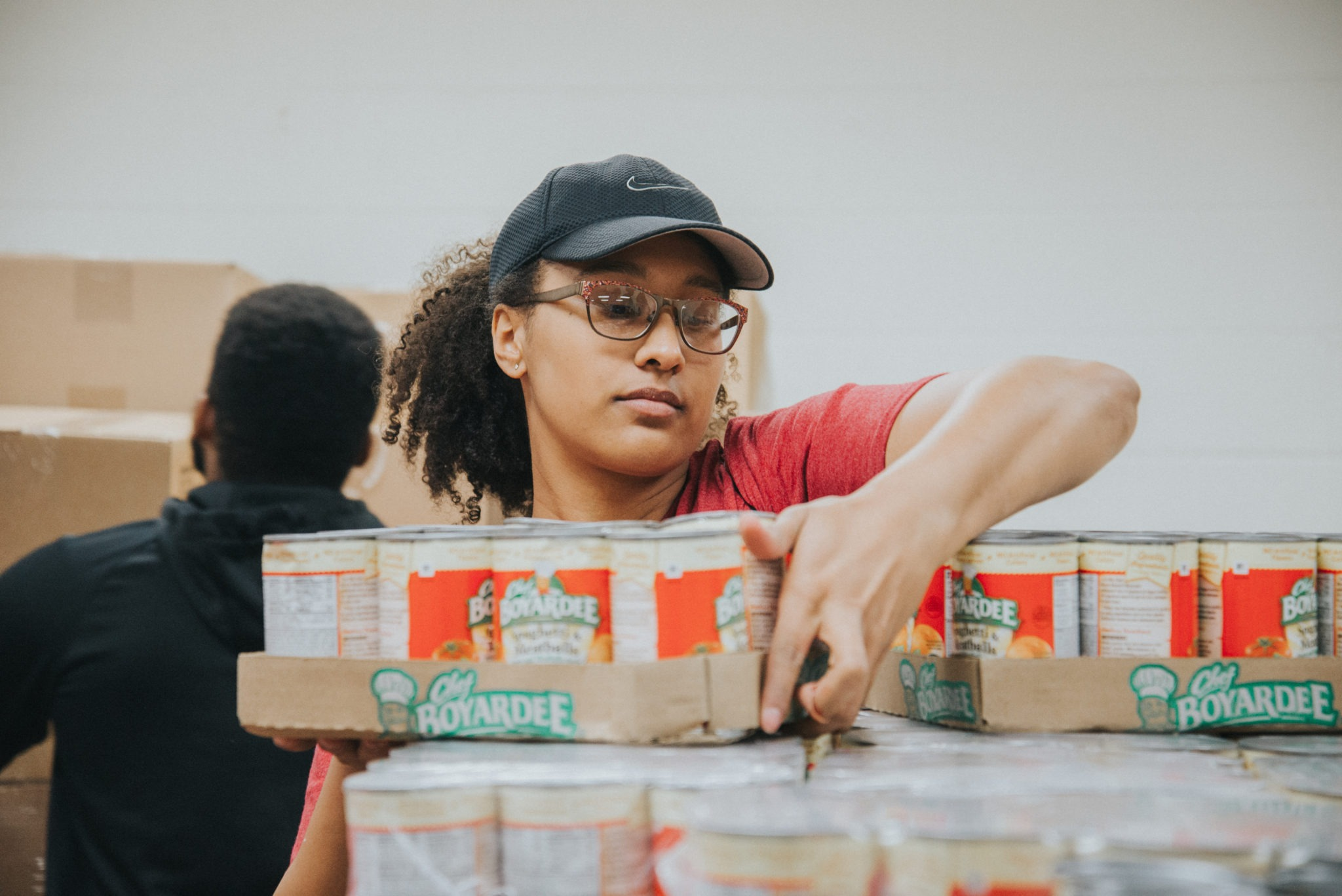 A Mercer University student volunteers at the food bank.