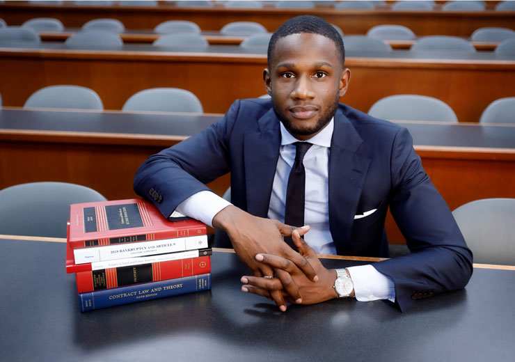 Law student poses with law books