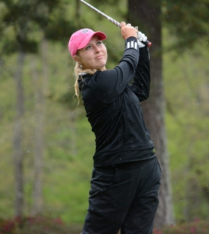 Women's golf player Lauren Lightfritz takes a swing.