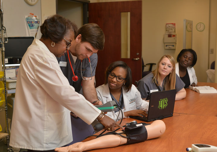 Nursing students learn from professor