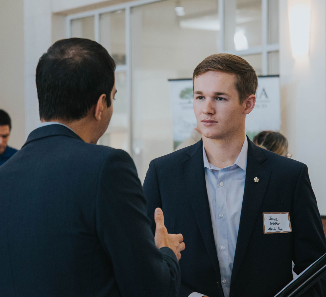 Student networking at career fair