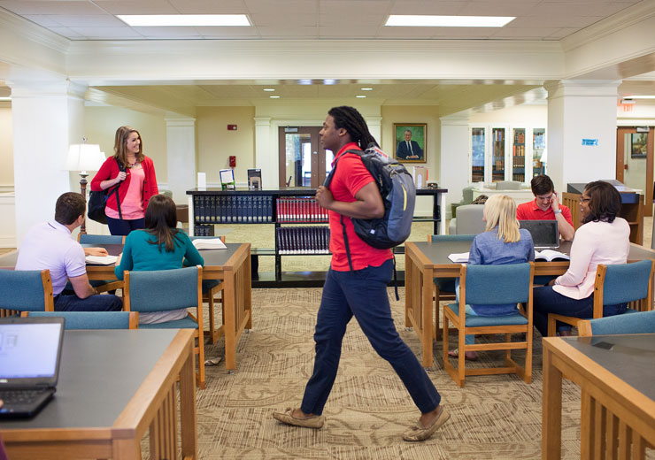 Students study inside the Furman Smith Law Library in Macon.