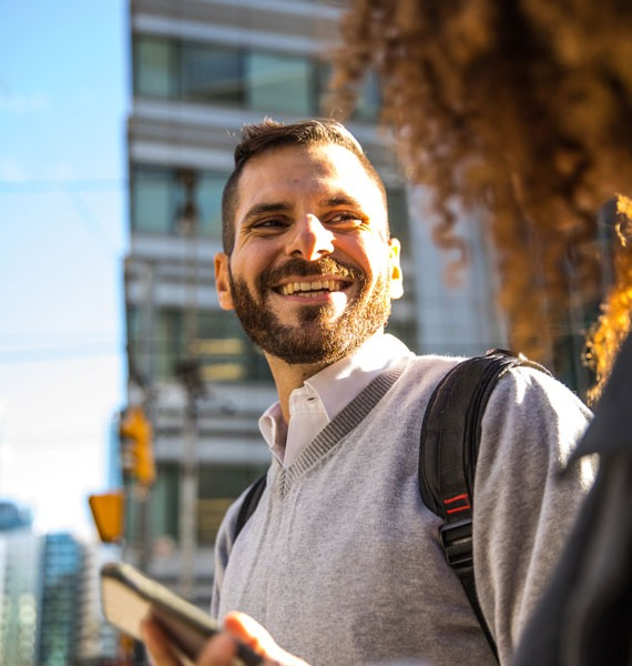 Adult student smiling in city