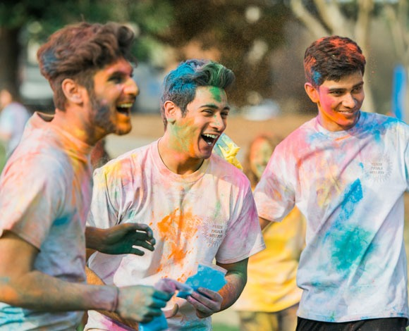 Students participating in Holi Festival