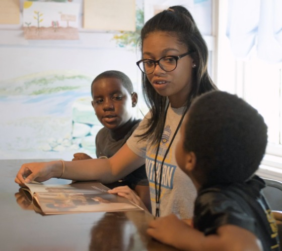 Mercer student NaShaya Bartolo works with kids in Freedom School.