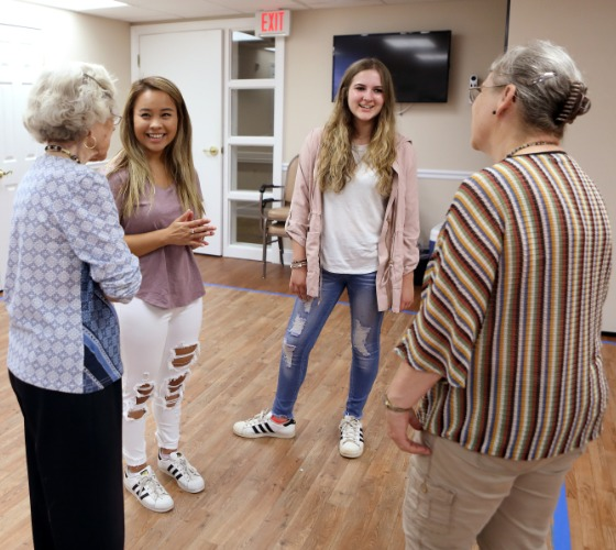 Two Mercer students chat with two residents of Carlyle Place
