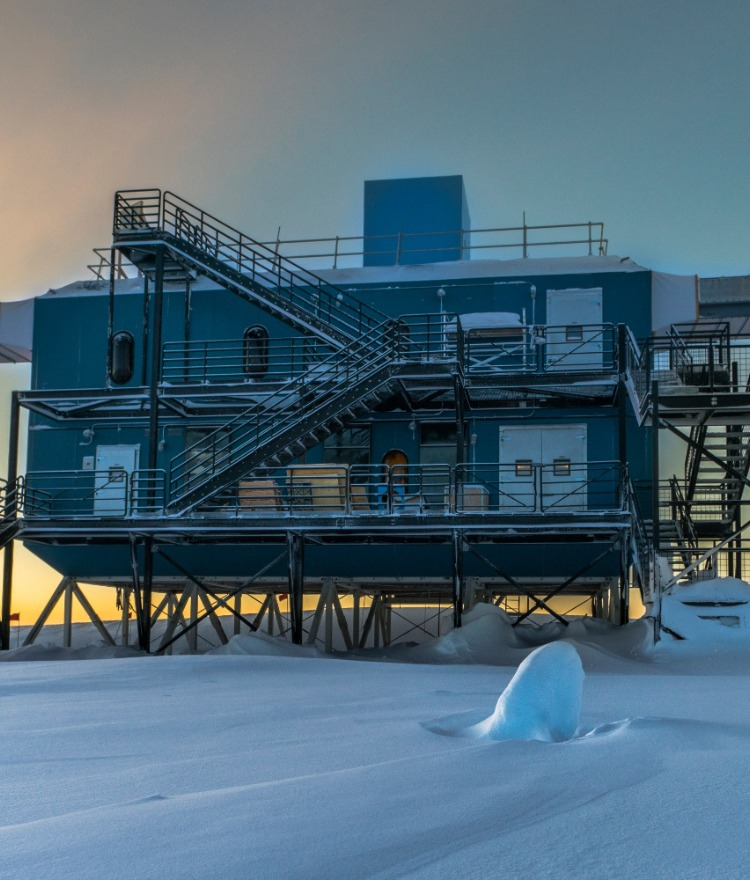 The IceCube Neutrino Observatory is pictured at sunset in 2017. (Photo by Martin Wolf, IceCube/NSF