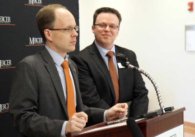 Dr. Jacob Warren and Dr. Bryant Smalley speak at a podium
