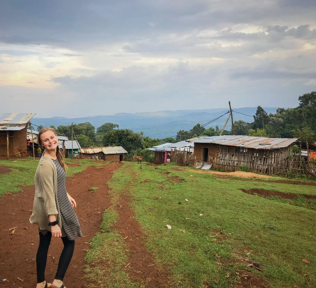 Kaitlyn Koontz stands on a dirt road in her village in Ethiopia