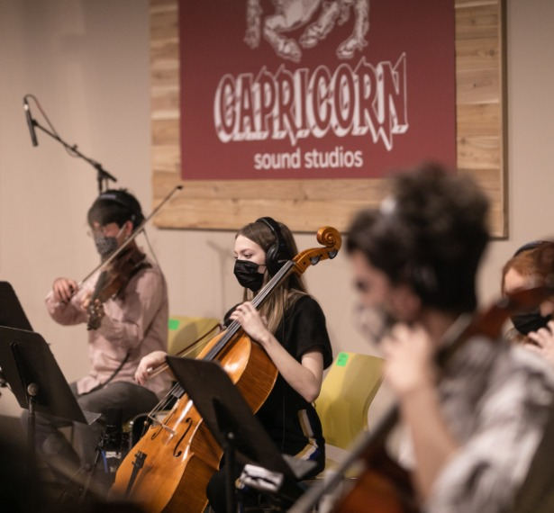mercer students playing strings instruments record in capricorn sound studios